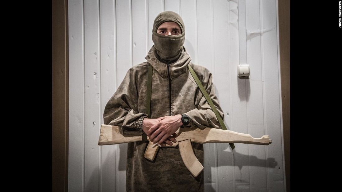 A fighter holds a wooden gun during training at a Right Sector training camp in the Carpathian Mountains.