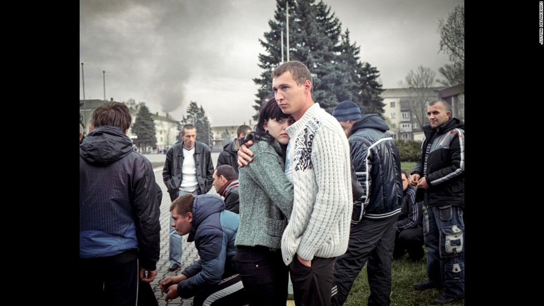 "A couple stand with a pro-separatist ""civil self-defense"" group of locals. They were unarmed and kept vigil by the administrative building in Yenakiieve, the birthplace of ousted President Viktor Yanukovych.<br />"