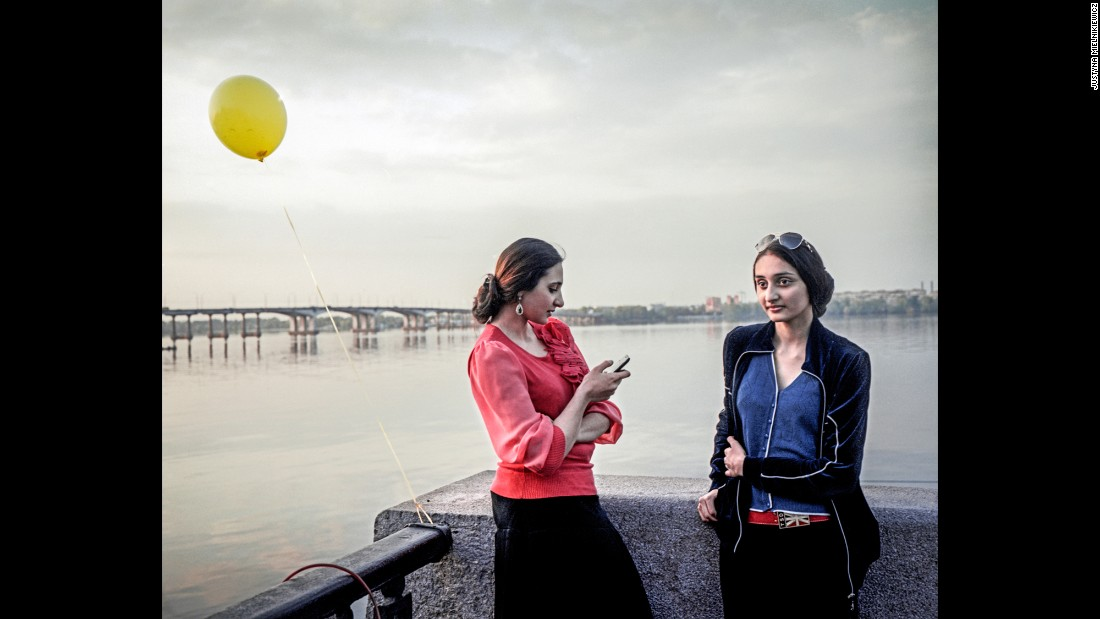 Sisters stroll along the Dnieper River. <br />