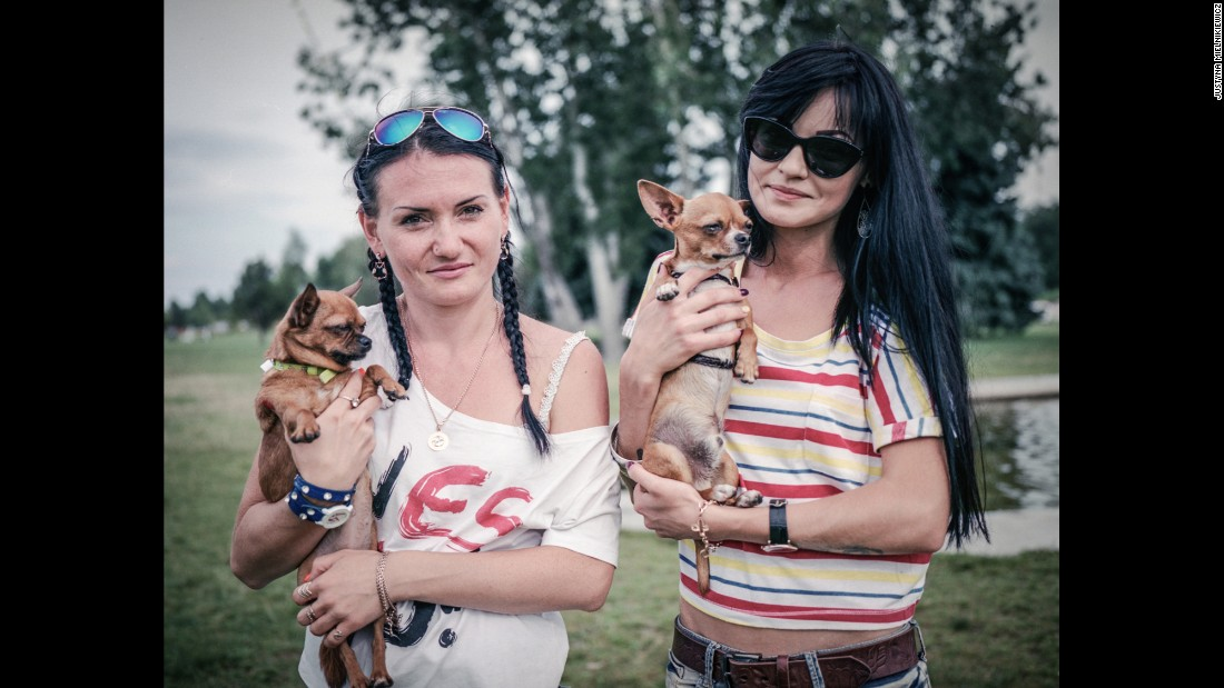 Ukranian women pose with their dogs in Cherkasy.