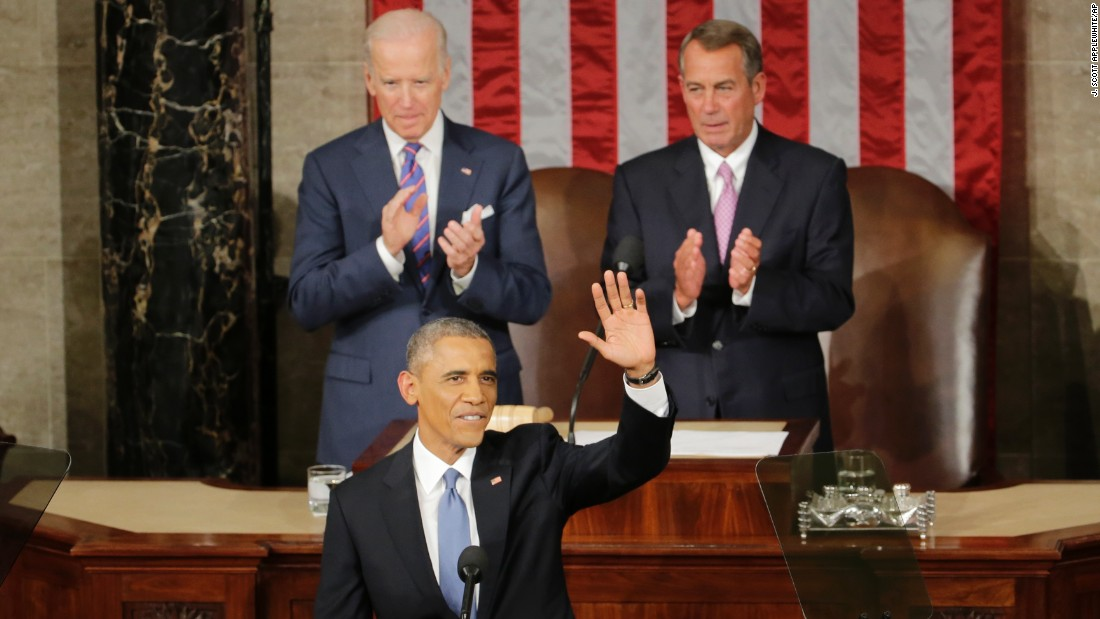 Obama acknowledges applause as he arrives to give his speech. House Speaker John Boehner of Ohio, right, and Vice President Joe Biden applaud.
