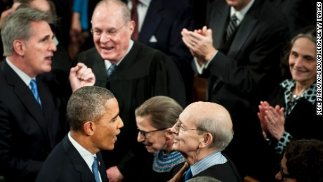U.S. President Barack Obama, center left, speaks with Supreme Court Justice Stephen Breyer, center right, as he enters the House Chamber to deliver the State of the Union address to a joint session of Congress at the Capitol in Washington, U.S., on Tuesday, Jan. 20, 2015.