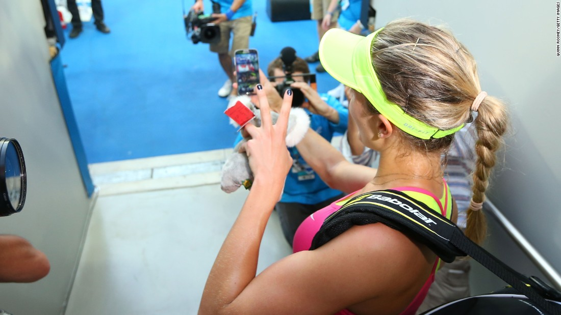 It's 2015, so selfies are nothing new. Here Eugenie Bouchard takes one after beating Kiki Bertens.