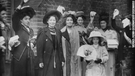 Suffragettes Emmeline Pankhurst (center) and her daughter Christabel Harriette (third from left), are welcomed by friends and supporters upon their release from prison in 1908.