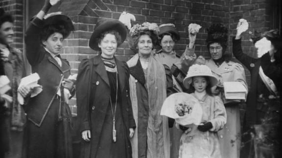 English suffragettes Emmeline Pankhurst (center) and her daughter Christabel Harriette (third from left) are cheered by supporters after their release from prison in 1908.