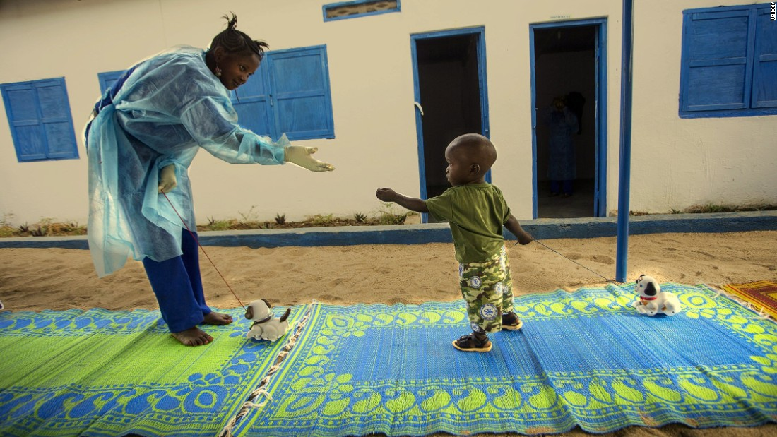 A worker at a UNICEF-supported Interim Care Center plays with 19-month-old Ebola survivor Tamba in Gueckedou, Forest Region, Guinea on January 11, 2015. Tamba's mother died of Ebola, then his father abandoned him for fear of catching the disease himself. UNICEF is working to break down the stigma around Ebola so children like Tamba still have homes to go to.