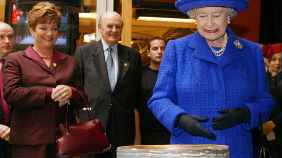 Her Majesty accepts a bowl given to her during a tour of Sheridan College in Oakville, Canada.