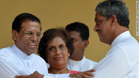 President Maithripala Sirisena (L) with Sarath Fonseka during campaigning in Colombo on Dec. 1, 2014