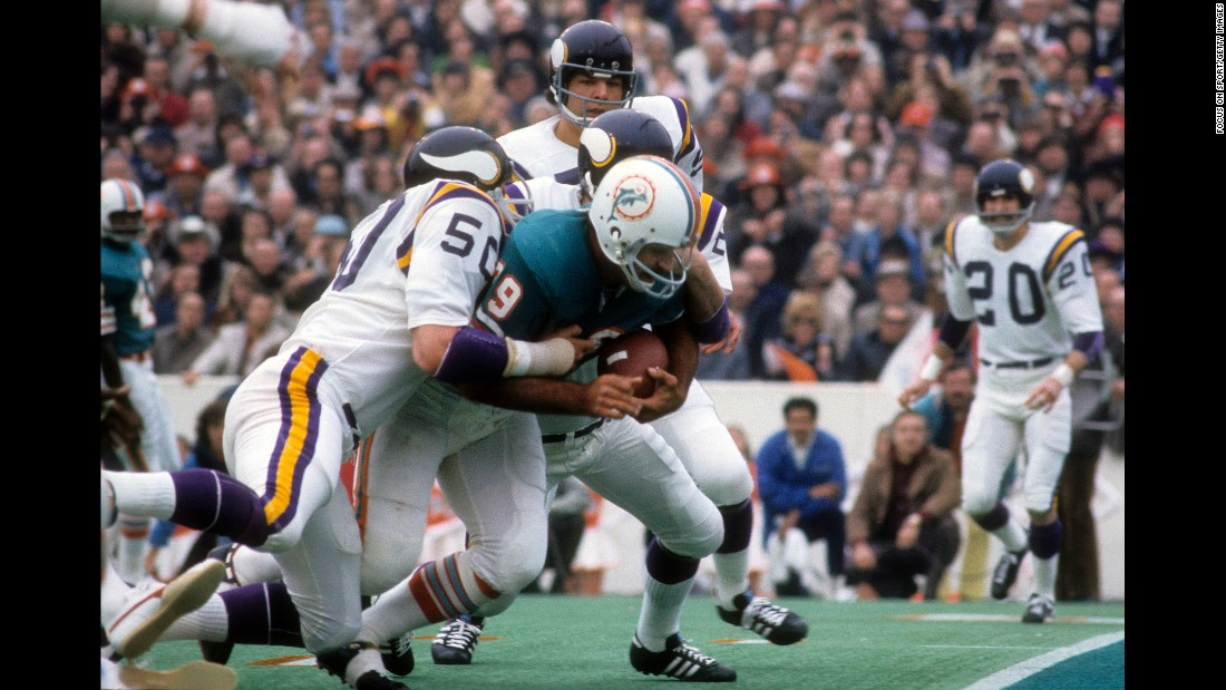 Powerful running back Larry Csonka carries two Minnesota defenders near the end zone as Miami won its second Super Bowl in a row. Csonka became the first running back to win Super Bowl MVP, rushing for 145 yards and two touchdowns.
