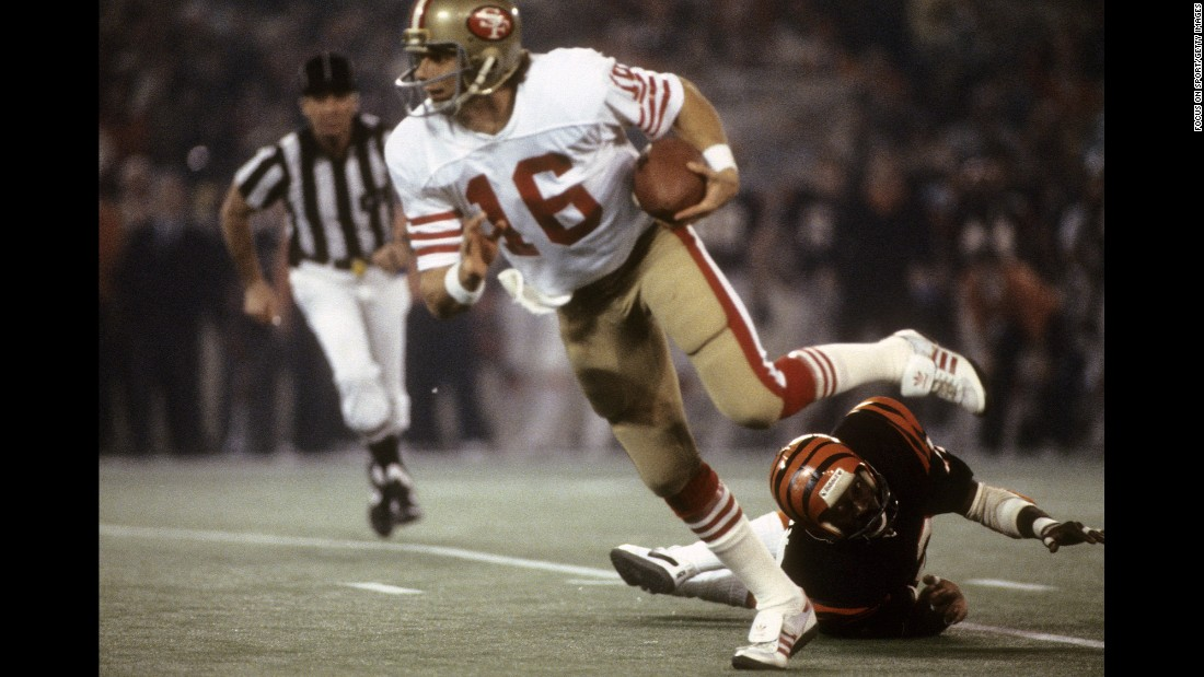 San Francisco 49ers quarterback Joe Montana evades a tackle en route to winning MVP honors in Super Bowl XVI. Montana threw for one touchdown in the game and ran for another as the 49ers won 26-21.