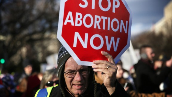 WASHINGTON, DC - JANUARY 22: A pro-life activist holds a sign as he participates in the annual March for Life January 22, 2015 in Washington, DC. Pro-life activists gathered in the nation's capital to mark the 1973 Supreme Court Roe v. Wade decision that legalized abortion. (Photo by Alex Wong/Getty Images)