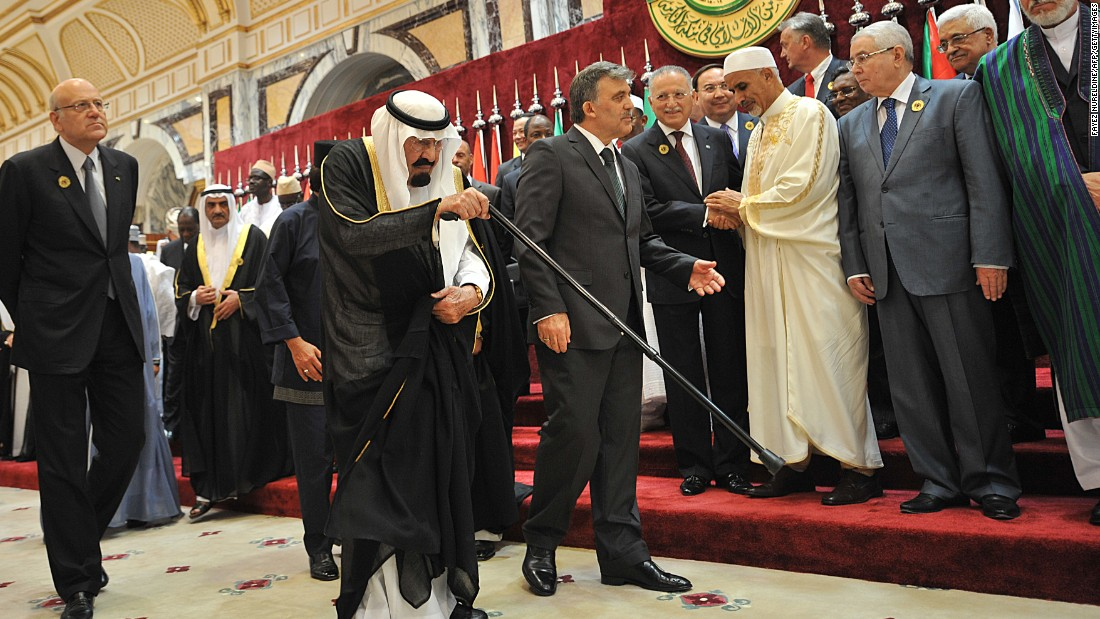 King Abdullah is escorted by Turkish President Abdullah Gul as Lebanese Prime Minister Najib Mikati, left, walks alongside them during a summit in Mecca, Saudi Arabia, in August 2012.