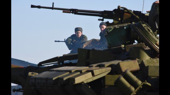 Rebels sit atop a tank at a checkpoint north of Luhansk, Ukraine, on Wednesday, January 14.
