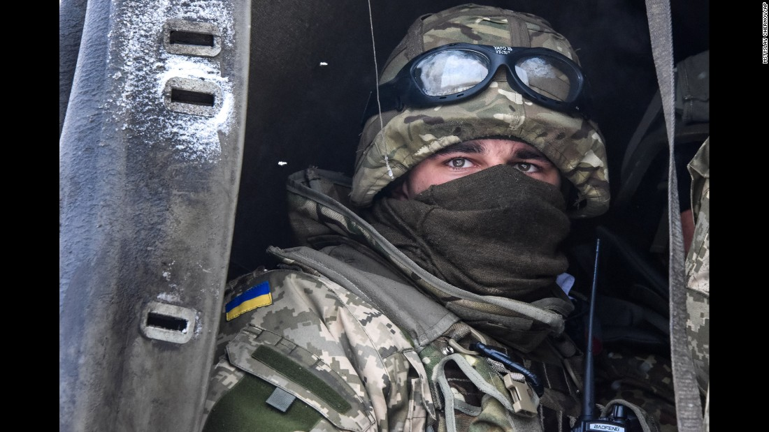 A Ukrainian soldier looks down from a military truck at the Donetsk airport on Tuesday, January 6. The airport has been the scene of some of the fiercest fighting in eastern Ukraine.
