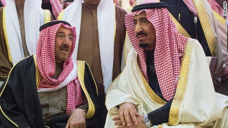 In this photo provided by the Saudi Press Agency, Saudi Arabia's newly enthroned King Salman, right, talks with Kuwait's Emir Sheikh Sabah Al-Ahmad Al-Jaber Al-Sabah during the funeral of Salman's half brother King Abdullah at the Imam Turki bin Abdullah mosque in Riyadh, Saudi Arabia, on Friday.