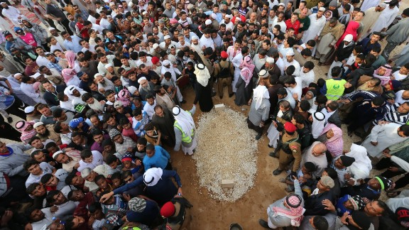Mourners in Riyadh, Saudi Arabia, gather around the grave of King Abdullah bin Abdulaziz al Saud on Friday, January 23. Thousands gathered in Riyadh to pay their respects to King Abdullah, who died early in the day at the age of 90.