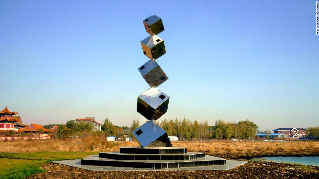 "Swiss artist Ralfonso creates sculptures driven by the wind. Pictured is ""Cube Tower"" -- a stainless steel creation at Changchun International Sculpture Park in China. The cubes rotate in different directions on an invisible vertical pole."