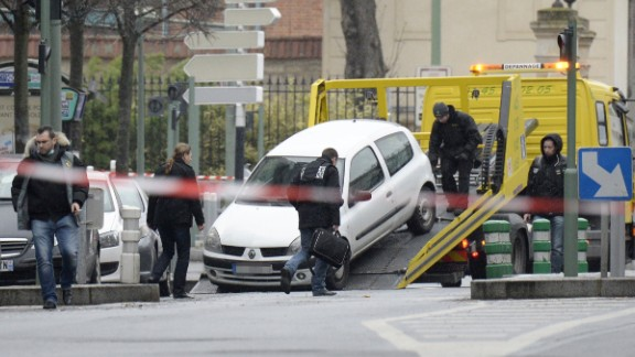A car belived to be have been used by an attacker who shot dead a female police in Montrouge, a southern suburb of Paris, is loaded onto the back of a truck in the suburban town of Arceuil on January 8, 2015.