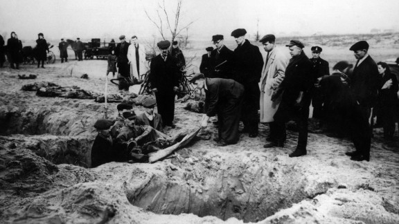 Civilians and soldiers recover corpses from common graves shortly after the liberation. Historians estimate more than 1 million Jews, Gypsies, Soviet prisoners of war and Poles were murdered at the camp.