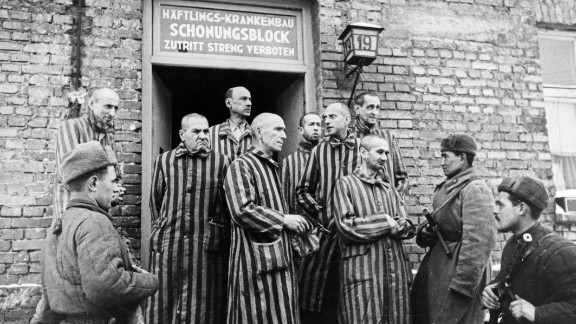 Soviet soldiers are seen with liberated prisoners.