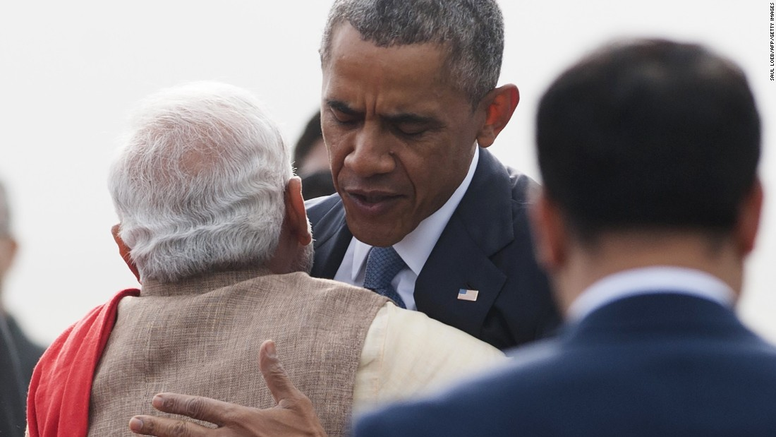Modi hugs Obama after Obama's arrival in New Delhi.