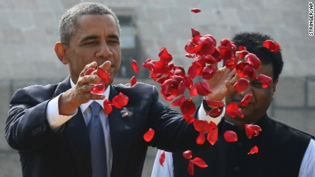 Obama offers floral tribute at the site where Indian independence icon Mahatma Gandhi was cremated in New Delhi.