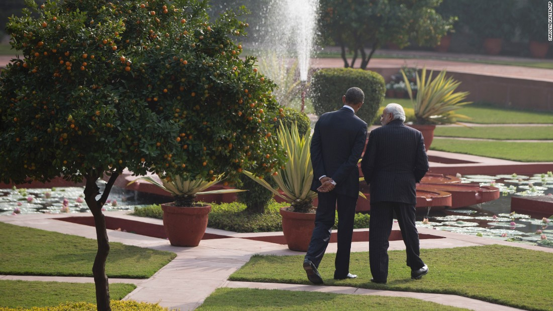 Obama and Modi walk in the gardens of the Hyderabad House.