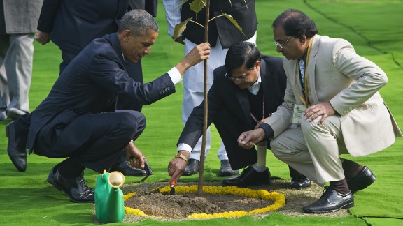 Obama participates in a tree planting ceremony at Raj Ghat, the Mahatma Gandhi Memorial.