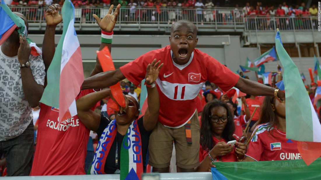 Equatorial Guinea fans celebrated wildly after their team reached the knockout stages of the Africa Cup of Nations on home soil.