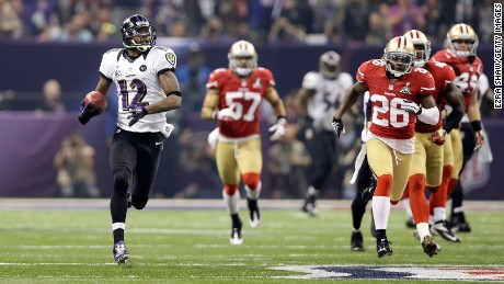 NEW ORLEANS, LA - FEBRUARY 03:  Jacoby Jones #12 of the Baltimore Ravens returns the opening kick-off for the second half 108-yards for a touchdown against Tramaine Brock #26 of the San Francisco 49ers during Super Bowl XLVII at the Mercedes-Benz Superdome on February 3, 2013 in New Orleans, Louisiana. The Ravens won 34-31.  (Photo by Ezra Shaw/Getty Images)