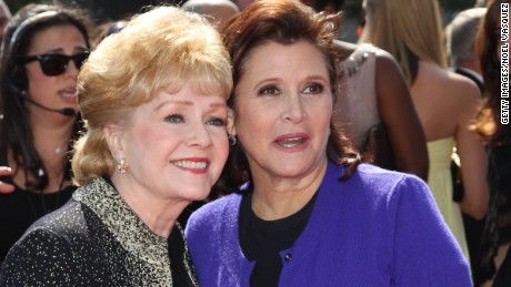 Debbie Reynolds poses with her daughter, Carrie Fisher, in 2011.