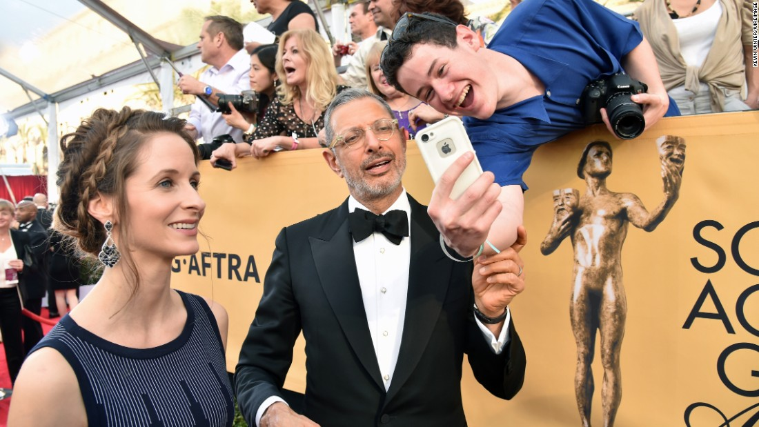Emilie Livingston and Jeff Goldblum take a selfie with a fan in Los Angeles after arriving for the Screen Actors Guild Awards on Sunday, January 25.