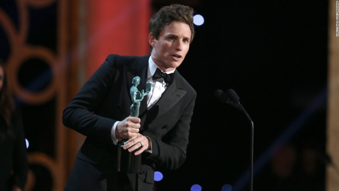 "Eddie Redmayne accepts an award for his leading role performance in ""The Theory of Everything."" Redmayne played physicist Stephen Hawking."