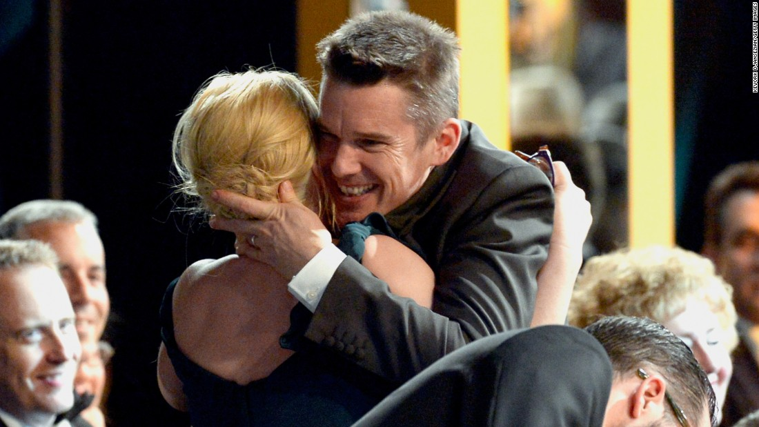 "Ethan Hawke embraces ""Boyhood"" co-star Patricia Arquette. She won outstanding actress in a supporting role."