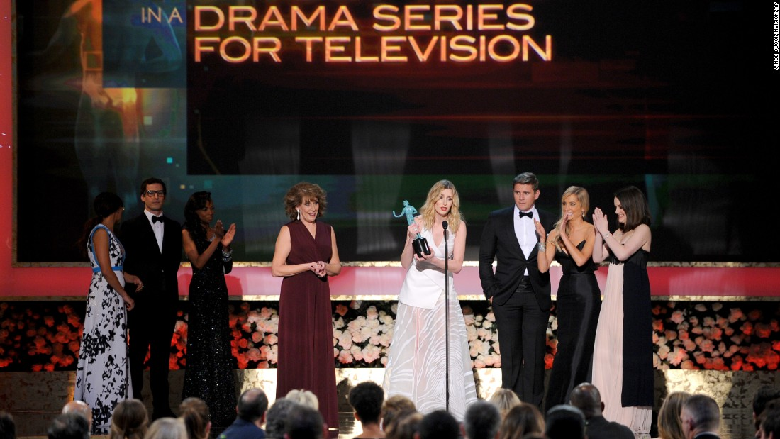 "Joanne Froggatt, center, and the cast of ""Downton Abbey"" accept the award for outstanding ensemble in a drama series."