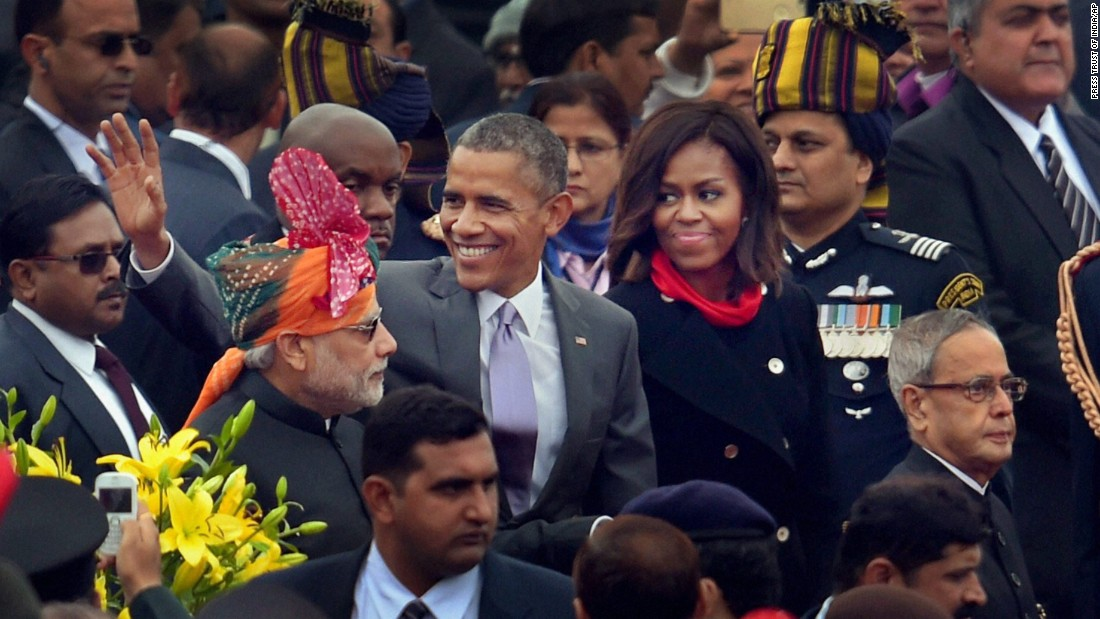 Obama waves to the crowd as he walks with Modi, left, and first lady Michelle Obama after the annual Republic Day parade in New Delhi on January 26.