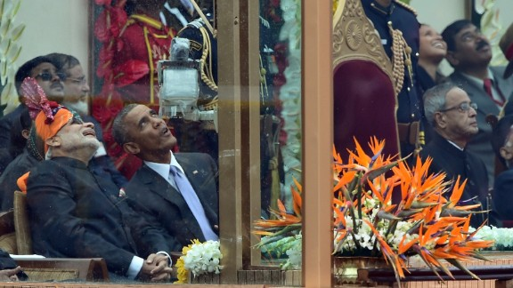 Modi talks with Obama as they watch jets fly overhead during the Republic Day parade on January 26.