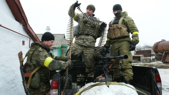Ukrainian servicemen prepare ammunition at a position on the front line near Mariupol on January 26.