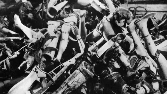Prosthetic limbs taken from executed prisoners are seen in a pile at the camp.
