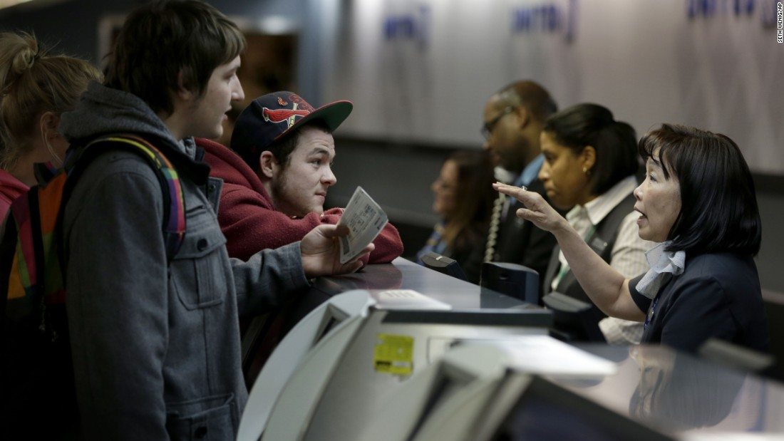 Passengers talk with a ticket agent at LaGuardia Airport to try to beat the snowstorm on January 26.