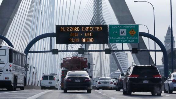 Commuters travel across the Zakim Bunker Hill Bridge into downtown Boston on January 26.