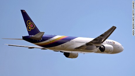 This picture taken in Tangerang on March 18, 2013 shows a Thai Airways Boeing 777 plane flying over the Sukarno-Hatta airport in Tangerang. Thai Airways was founded in 1960, and operates domestic, regional and intercontinental flights radiating from its home base in Bangkok to key destinations around the world and within Thailand. AFP PHOTO / ADEK BERRY (Photo credit should read ADEK BERRY/AFP/Getty Images)