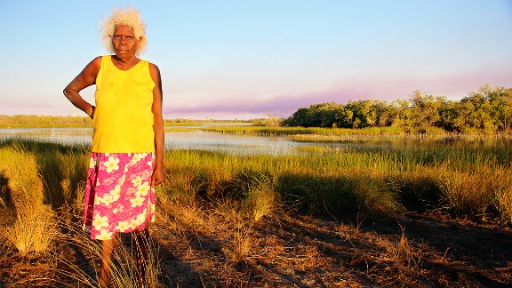 Peace Woolla stands in front of a lake on Wik homelands, Far North Queensland.