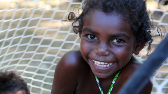 A young girl from Aurukun in Far North Queensland smiles. A campaign is under way to include Aboriginal and Torres Strait Islanders in Australia's constitution. A nationwide referendum is expected to be held in 2017.