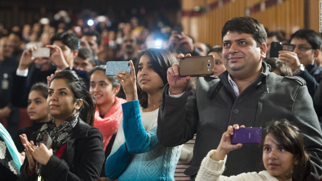 Guests use cell phones to record Obama as he speaks at the town hall event on January 27.