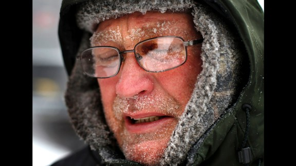 Snow clings to a man's face as he shovels a sidewalk in Portland, Maine, on January 27.