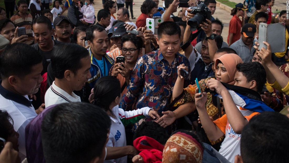 "Near the riverbank, an elderly woman approached Jokowi.<br /><br />""She asked my number -- telephone number!""<br /><br />""Things are getting a little too friendly,"" Amanpour said with a smile."