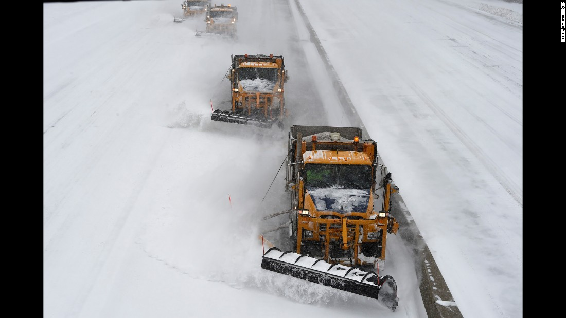 Plows clear snow off the Long Island Expressway in Melville, New York, on January 27.