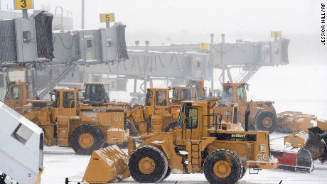 Plows line up at airplane gates as Bradley International Airport in Windsor Locks, Connecticut, on January 27.