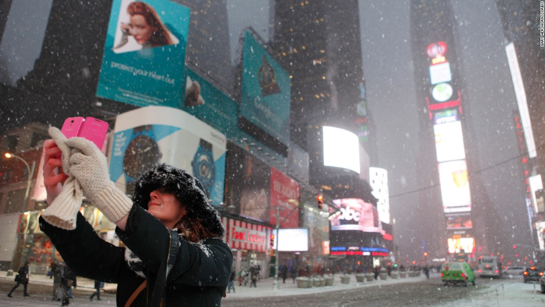 A woman takes a selfie in New York's Times Square on Monday, January 26.